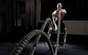 man-doing-crossfit-rope-work-large